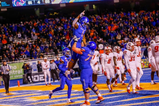 Nov 16, 2019; Boise, ID, USA; Boise State Broncos wide receiver Octavius Evans (1) and offensive lineman John Molchon (77) celebrate Evans touchdown during the first half versus New Mexico Lobos at Albertsons Stadium. Mandatory Credit: Brian Losness-USA TODAY Sports