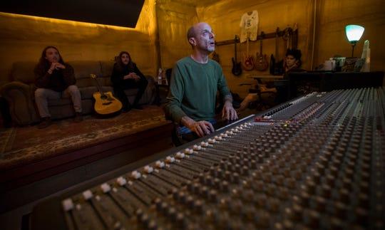 Howard Wulkan operates the sound board at Farmadelica Sound studios in Bokeelia.