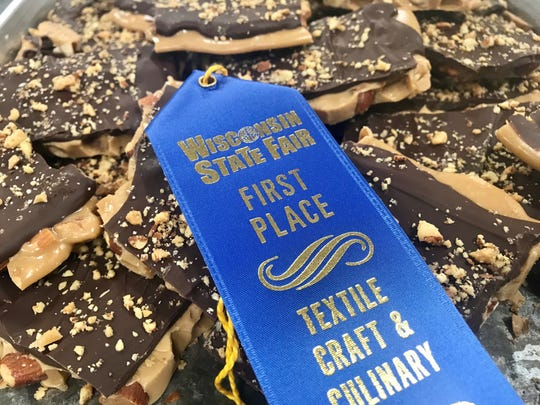 Julie Swan of De Pere won a blue ribbon and the Best of Show Award at this year's Wisconsin State Fair for her dark chocolate toffee she sells as Aunt Julie's Gourmet Toffee.