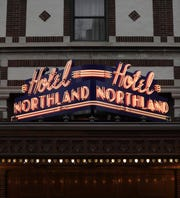 A neon Hotel Northland sign was installed Monday above the downtown Green Bay hotel's Pine Street entrance The sign is a replica of the hotel's historic sign.