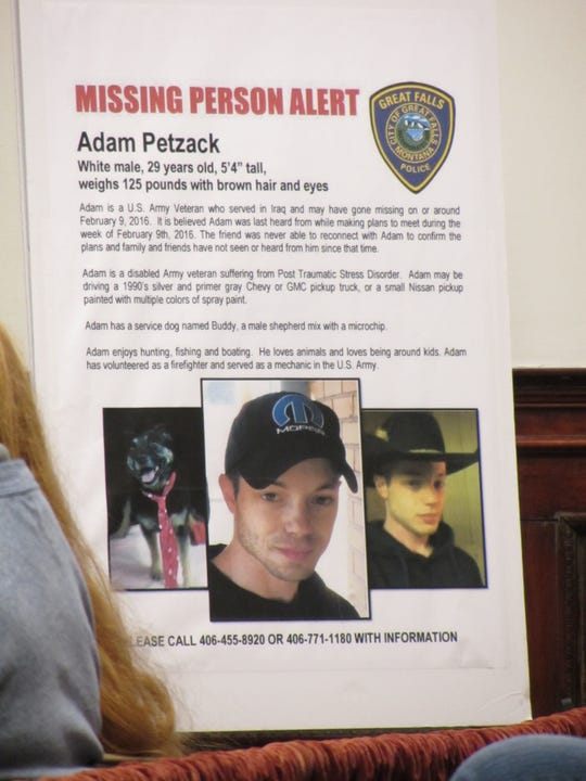 Adam Petzack's missing person poster sits before the jury during the homicide trial of Brandon Lee Craft Monday, Nov. 18, 2019.