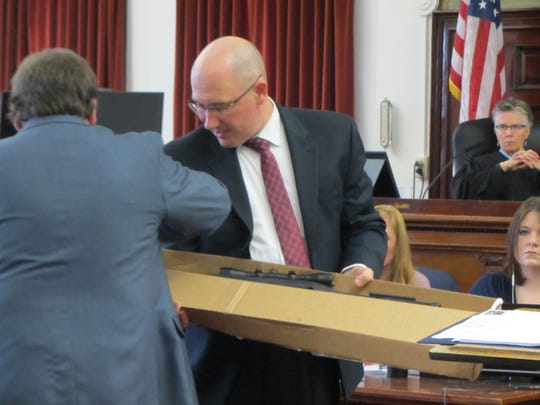 Assistant Cascade County Attorney Kory Larsen, left, assists Cascade County Attorney Josh Racki with evidence in the homicide trial of Brandon Lee Craft  Monday, Nov. 18, 2019.