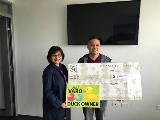 Guam Gift Baskets a locally owned business proudly donated $500 to Victim Advocates Reaching Out (VARO) Organization on Sept. 30. Pictured from left: Former Speaker Judy Won Pat, a proud VARO Duck Owner, and Charlie Hermosa, Owner, Guam Gift Baskets.