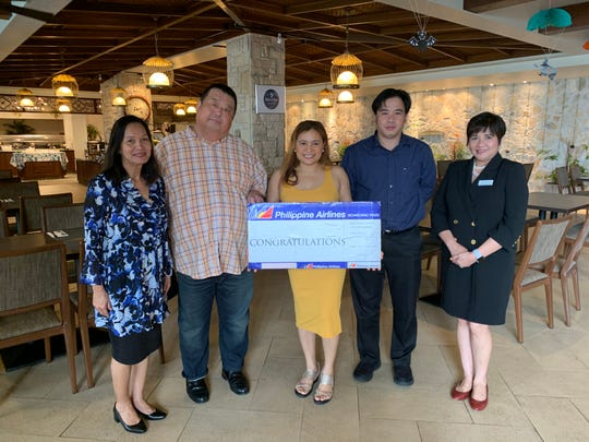 Connie Mayers, Philippine Airlines sales manager, Yasuhiro Kotera, President and GM of Guam Reef Hotel, Thelma Nirva, grand prize raffle winner, Josefh Fajardo, GM of PAL and Chito De Guzman-Aguilo,