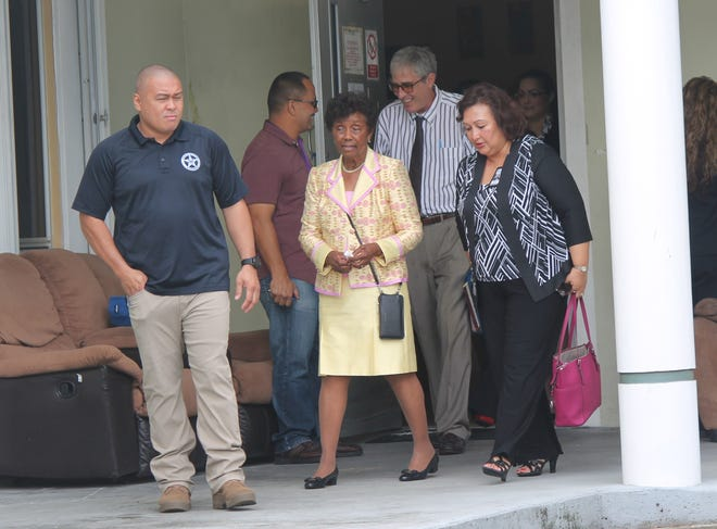 Chief Judge Consuelo Marshall, center, in yellow dress, leaves Asan's Asusena mental health residential facility Nov. 18 following a tour of the facility. At right is Guam Behavioral and Wellness Center Director Theresa Arriola, and exiting the door is attorney Daniel Somerfleck, who filed the 2001 lawsuit that placed mental health services under court control.