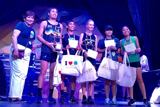 Chito de Guzman-Aguilo, event chairman and F&B director of Guam Reef Hotel is pictured with the top overall winners of the 13th annual Guam Reef Costume Run/Walk To wishes held Oct. 27 - Derek Mendel, Ryan Matienzo, Kris Lawrence, Yumika Sugahara and Tammy Nierva.