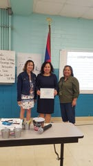 Appreciation: Janice Chargualaf, principal of Adacao Elementary School presented classroom management techniques during Guahan Academy Charter School professional development day on Nov. 12. From left: Lynda Hernandez-Avilla, dean of Secondary Guahan Academy Charter School, Chargualaf, and Mary Mafnas, Dean of Elementary Guahan Academy Charter School.