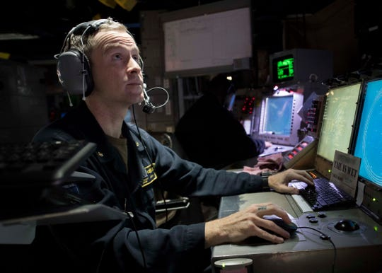 """LOCAL NATIVE KEEPSWATCH: Somewhere in the Atlantic Ocean last Saturday, Lieutenant Commander Jamie Jordan of the U.S. Navy -- from Henderson-- mans his post during an under sea warfare drill. Jordan is a combat systems officer aboard the Arleigh Burke-class guided-missile destroyer USS Carney (DDG 64). The Carney, which is forward-deployed to Rota, Spain, is on its seventh patrol in the U.S. 6th Fleet area of operations in support of regional allies and partners as well as U.S. national security interests in Europe and Africa. Interesting side note: The USS Carney was featured in the 2017 action film """"American Assassin."""""""