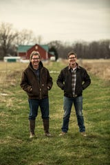 Jeff Hawkins, left, with son Zach Hawkins. The pair run Hawkins Family Farm in North Manchester, Ind.