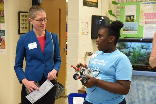 Councilmember Stephanie Welch learning about programming robots from a student at PolitiCode at the University of Tennessee in Knoxville.