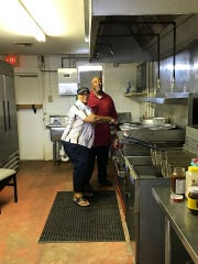 Jeaux's owner and operator Marcus Cormier Sr., seen here with his mom, Joséphiné. Cormier opened Jeaux's in the location where Joséphiné ran her restaurant, Joséphiné's Creole restaurant, in St. Martinville.