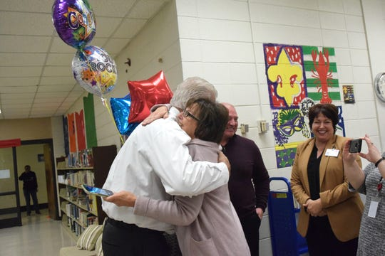 Carencro Middle School Principal Jeff Jeanette hugs Director of Middle and Secondary Schools Kathy Aloisio after being surprised with the Lafayette Parish Principal of the Year Award on Nov. 18, 2019.