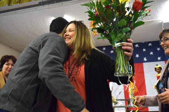 Prairie Elementary School Principal Cayce Booher hugs Chief Academic Officer Dr. Mark Rabalais after being surprised with the Principal of the Year Award on Nov. 18, 2019.
