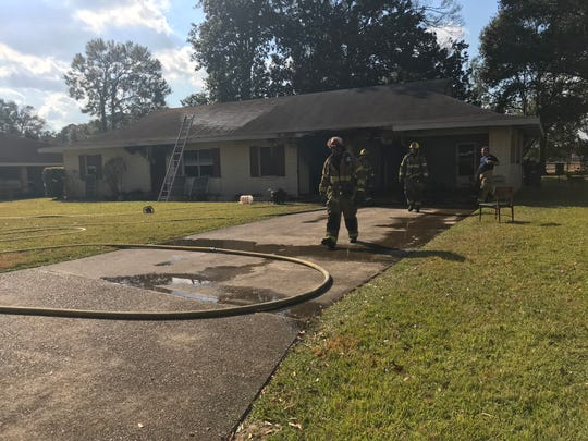Lafayette firefighters extinguish a fire Monday on Ridgeview Drive.