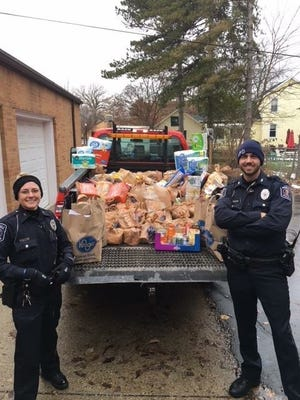 Officers from the Howell Police Department collect food for Cram the Cruiser event in 2018.0