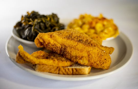 The catfish dinner at Dasha Barbours Southern Bistro with a side of collard greens and macaroni and cheese.