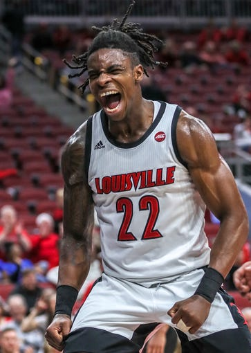 Aidan Igiehon celebrates after dunking in the closing minutes of Louisville's game against North Carolina Central.
