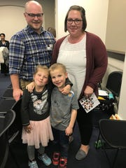 Julianne Vantland, right, testified Monday at the final meeting of the Public Assistance Reform Task Force in Frankfort about the importance of state aid to her family. She is pictured with her is husband, Drew Vantland, and their children, 5-year-old twins Evelyn (left) and Rowan. Nov. 18, 2019