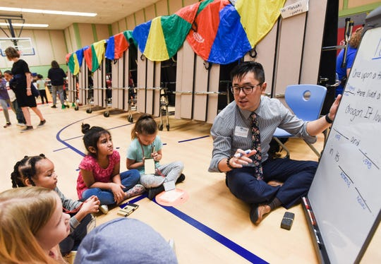 Poet Masaki Takahashi works with kids at Riddle Elementary School Thursday, Sept. 12, 2019.  Students got a chance to meet and work with local area artists as part of Pay-it-Forward Day,