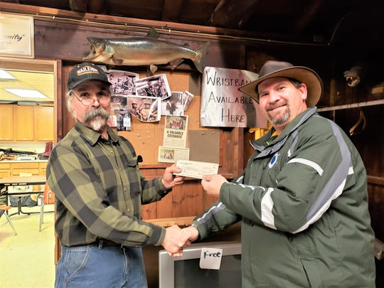 Pictured from left: Carl Bonde, president of the Maribel Sportsmen's Club, presents a check for $300 to Victor Novak to help start their new Denmark Fishing Club. The Denmark school will compete in the Wisconsin Interscholastic Fishing Association. Students will learn fishing skills and techniques as well as competing individually and as a team.