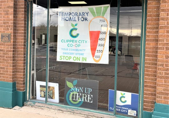 Window at Clipper City Co-op's temporary office at 822 Franklin St., downtown Manitowoc.
