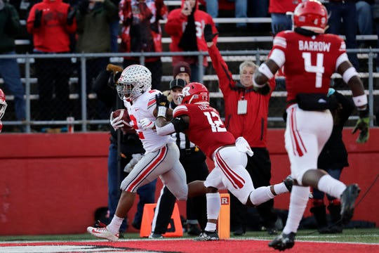 Ohio State tailback J.K. Dobbins scores on one of his two touchdown runs against Rutgers.