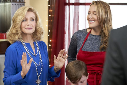 """From left, Donna Mills and Jill Wagner in """"Christmas Wishes & Mistletoe Kisses"""" on theHallmark Channel."""