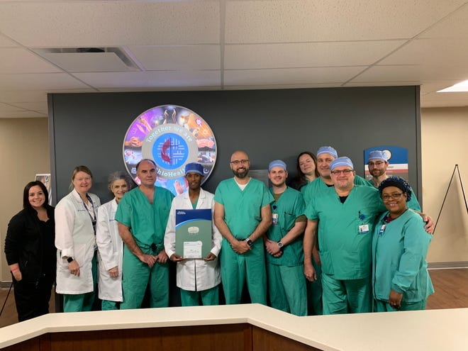 Yohannes Bayissa, MD, center, interventional cardiologist at Mansfield Hospital, performed the hospital's first Watchman procedure Nov. 7.