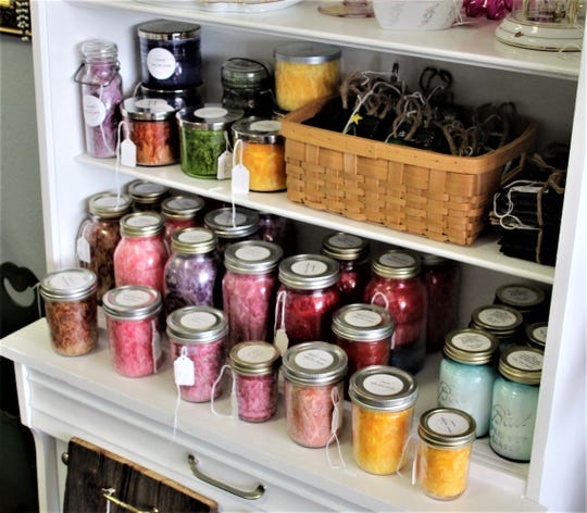 These candles are just a few of the hand-crafted products that Amy McDonald, owner of Blue Light Estate Sales and More, makes and sells at her new store on Mount Vernon Avenue in Marion.