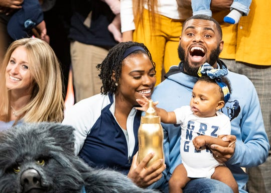 Hazel Dei Collier and her parents celebrate after winning the Memphis Grizzles Infie 500 baby race at the FedEx Forum on Sunday, Nov. 17, 2019.