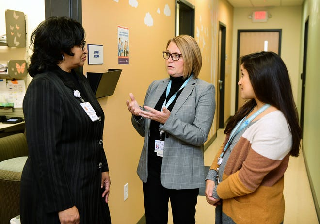 Amy Herbst, middle, Children's Wisconsin's vice president of mental and behavioral health, speaks with Stephany Pruitt, a psychotherapist, and Lynn Chowdhury, a pediatrician, at Children's Next Door Pediatrics Primary Care. Children's Wisconsin announced a plan to invest $150 million into its mental and behavioral services in the next five years, which includes placing a mental and behavioral health provider at all of its primary care locations.