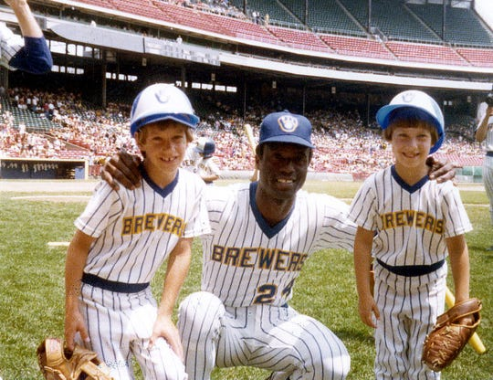 Craig Counsell (left) with Brewers player Ben Oglivie and Jennifer Counsell (right) in 1978 when the ball-in-glove logo was introduced.