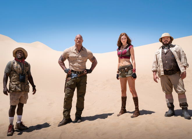 """The reluctant gamers, and their avatars (from left, Kevin Hart, Dwayne Johnson, Karen Gillan and Jack Black), are back for another round in """"Jumanji: The Next Level."""""""