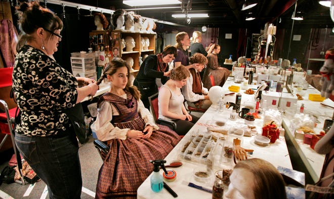 "Lara Leigh Dalbey, left, works on a cast member's hair during the Milwaukee Repertory Theater's 2008 production of ""A Christmas Carol."""