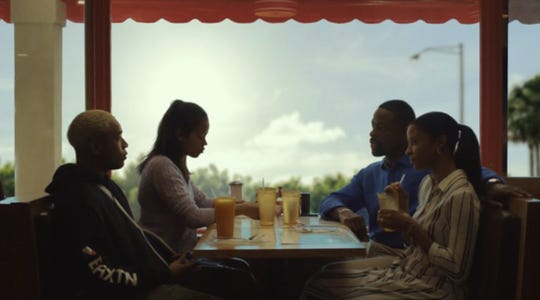 "Kelvin Harrison Jr., from left, Taylor Russell, Sterling K. Brown and Renee Elise Goldsberry take a moment in movie ""Waves."""