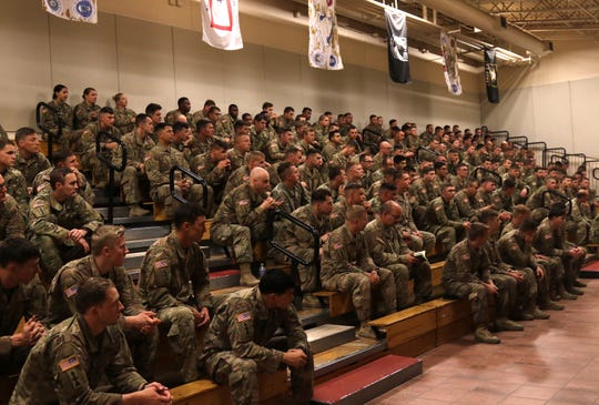 Senior Wisconsin Army National Guard leaders, including Brig. Gen. Joane Mathews, the deputy adjutant general for the Army, and Command Sgt. Maj. Rafael Conde, the Wisconsin National Guard's senior enlisted adviser, greet soldiers from the 2nd Battalion, 127th Infantry as they arrive at Fort Bliss, Texas, on Sunday following a deployment to Afghanistan.