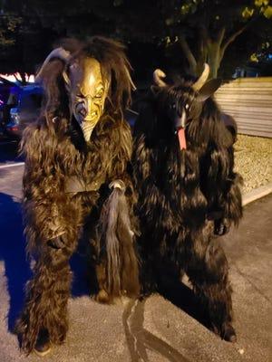 Robert Schoenecker and Izzy Jaecks of Milwaukee are members of Milwaukee Krampus Eigenheit.