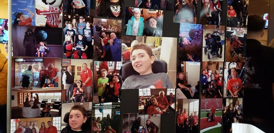 A poster board of photos is displayed at Champps Brookfield for the annual Kaden's Wish on Nov. 16 in honor of Kaden Stark. The 14-year-old died in September.