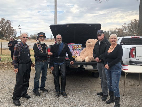 The 24th annual ABATE Toy Run raise $775 and at truck load of toys for Christmas Wish. Pictured are (from left)Gary Grimm, ABATE District 16 Vice President; Ray Coahran,ABATE District 16 member; Pat McLean, ABATE District 16 President; Jay Lanning, ABATE District 16 Sergeant at Arms; and Laura Frasco, ABATE District 16Secretary.