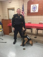K-9 handler Sgt. Jonathan Griffin (left) and his K-9, Harmon, are pictured with the new bullet and stab-protective best that was recently provided byVested Interest in K-9s, Inc. is a 501c(3) charity located in East Taunton, Mass.