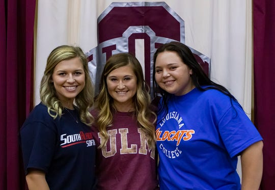 Abby Allen, left, Madelyn Fletcher and Alli Deiter pose for a photo after they signed college softball papers during a ceremony at Ouachita Parish High School in Monroe, La. on Nov. 18. Allen signed with South Alabama, Fletcher signed with ULM and Deiter signed to play with Louisiana College.