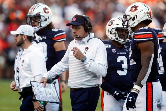 Auburn head coach Gus Malzahn talks to players on the sideline during a loss against Georgia, Saturday, Nov. 16, 2019, in Auburn, Ala.