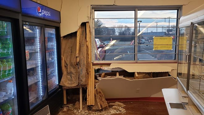 A car crashed into a new Low Bob's in Muncie on East Main Street early Monday morning, Nov. 18, 2019.