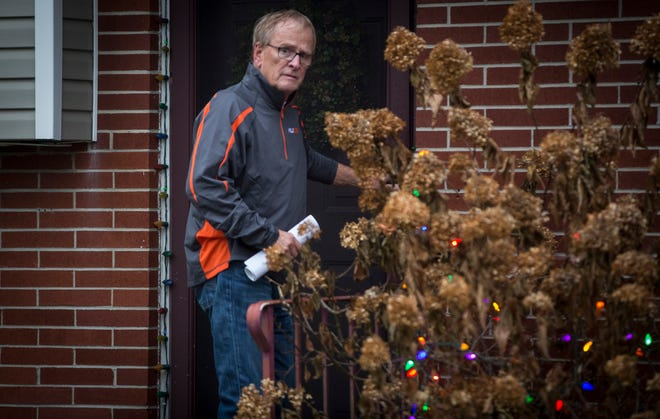 Muncie Mayor Dennis Tyler enters his home along North Manchester Road on Nov. 18, 2019 after being arrested by the FBI. Tyler was indicted for theft of government funds.