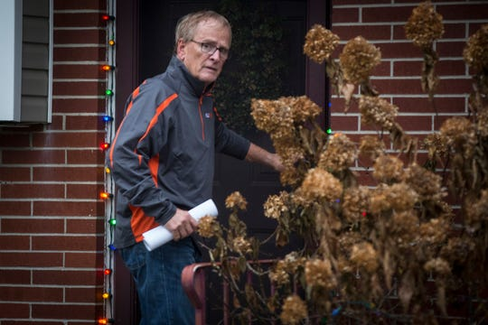 Muncie Mayor Dennis Tyler enters his home along North Manchester Road around 4:30 p.m. Monday after being arrested by the FBI. Tyler was indicted for theft of government funds.
