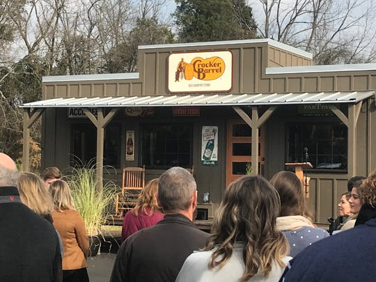 Cracker Barrel employees look at a new down-sized version of a typical store that will be used for promotional events including  New York City leading up to the 93rd Annual Macy's Thanksgiving Day Parade.