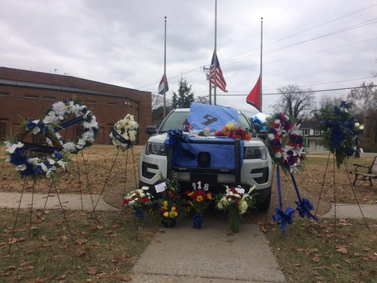 The Cheatham County Sheriff's Office parked a patrol cruiser in front of the county courthouse in Ashland City on Monday, where people could leave flowers, cards and messages for Deputy Stephen Reece's family. Reece died in a car crash Friday, Nov. 15.