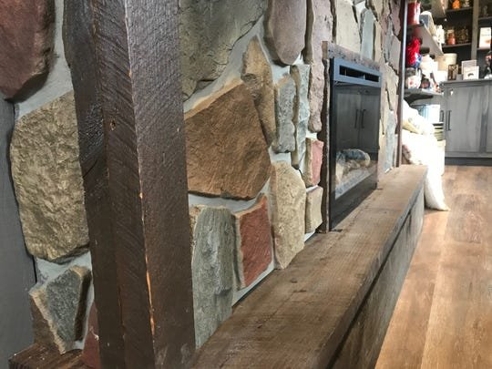 Reclaimed wood from the original Cracker Barrel Old Country Store surrounding a fireplace that is part of a scaled down store scheduled to be New York City next week.