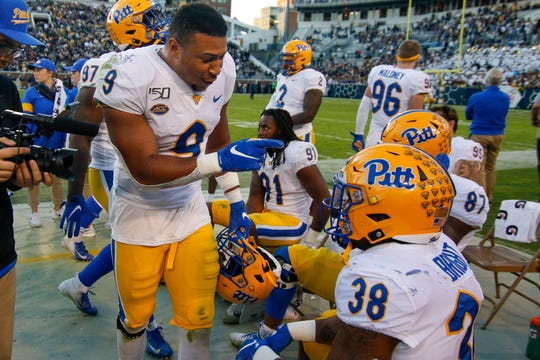 Nov 2, 2019; Atlanta, GA, USA; Pittsburgh Panthers linebacker Saleem Brightwell (9) congratulates linebacker Cam Bright (38) after a fumble recovery against the Georgia Tech Yellow Jackets in the third quarter at Bobby Dodd Stadium. Mandatory Credit: Brett Davis-USA TODAY Sports