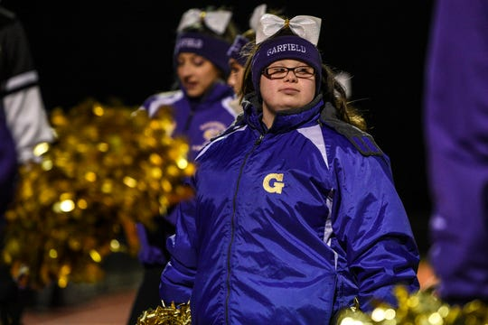 Jessica Alfonso, a Freshman and cheerleader at Garfield High who also happens to have Down syndrome cheers for the Garfield Football team as they play Rahway High School in Rahway on Friday November 8, 2019.